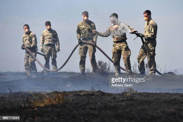 Soldiers from 4th Battalion Royal Regiment Scotland tackle wildfires near Swineshaw reservoir in Stalybridge on June 28 2018 in Stalybridge England...