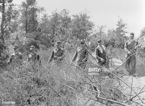 Soldiers from a military camp in Porter County in Indiana searching brush in the vicinity of Indiana Dunes State Park where 3 young women disappeared...