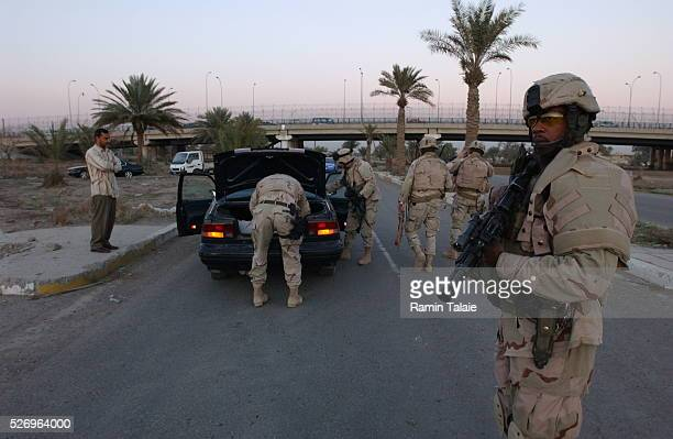 US soldiers from a New York National Guard unit the Fighting 69th stop a suspected vehicle on Route Irish the highway between Baghdad International...