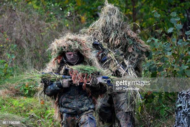 Soldiers from a sniper unit of the German armed forces Bundeswehr pracice during the informative educational practice 'Land Operation Exercise 2017'...