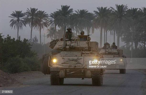 Soldiers from Alfa Company 1/18 Infantry, 4th Infantry Division out of Fort Carson, Colorado, patrol July 2, 2003 in the outskirts of Balad, 76 km...