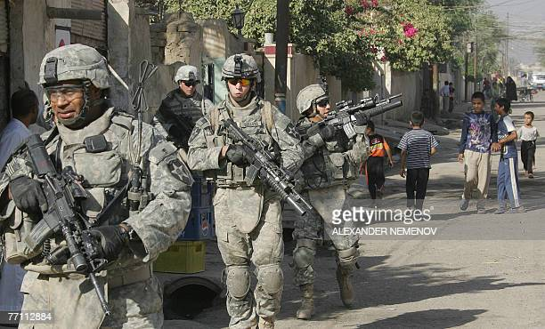 Soldiers from Alpha Company 1/38 Infantry Regiment patrol in downtown Baquba, 30 September 2007, some 50 kms north-east from Bagdad. US military...