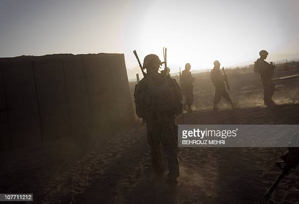 Soldiers from Alpha Troop 1-75 Cavalry 2nd Brigade 101st Airborne Division and Afghan National Army soldiers leave the Sabloghay camp on a foot...