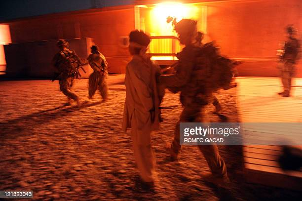 US soldiers from Bravo and Delta Company 287 Infantry Battalion 3rd Brigade Combat Team escort suspected Taliban insurgents to the Forward Operating...