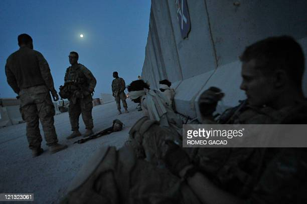 US soldiers from Bravo and Delta Company 287 Infantry Battalion 3rd Brigade Combat Team guard suspected Taliban insurgents at the Forward Operating...