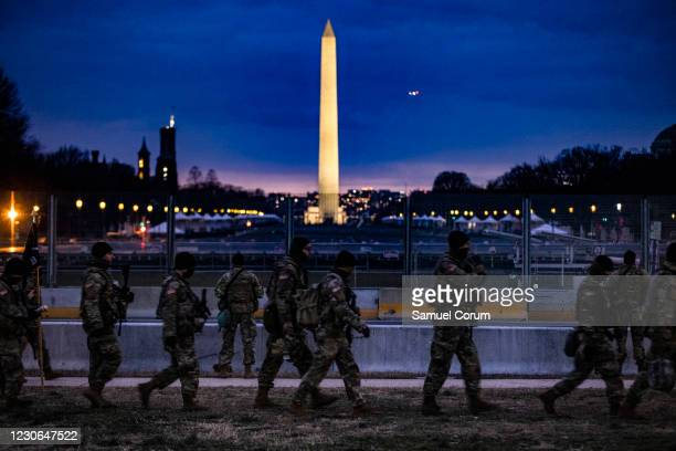 Soldiers from Bravo Company, 1st Battalion, 116th Infantry Brigade Combat Team, Virginia National Guard stand watch on the National Mall on January...