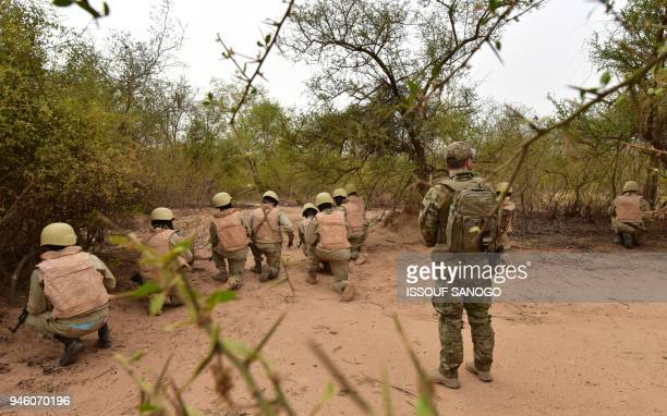 Soldiers from Burkina Faso take part in a training with Austrian army instructors at the Kamboinse General Bila Zagre military camp near Ouagadougo...