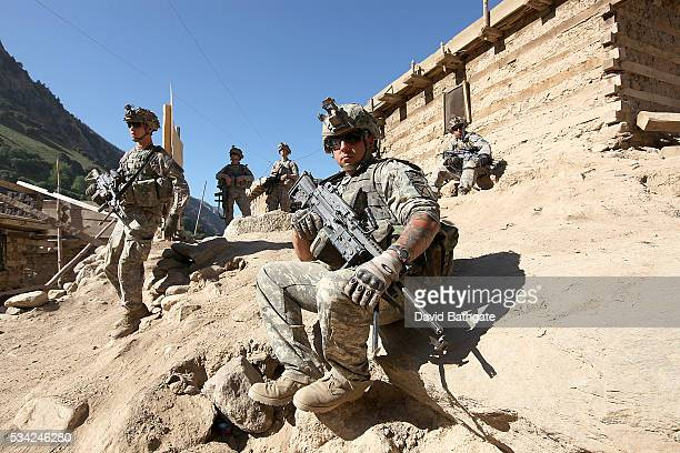 Soldiers from Charlie Company the US Army's 10th Mountain Division prepare to leave Firebase Lindstrom to patrol the town of Barge Matal Nuristan...