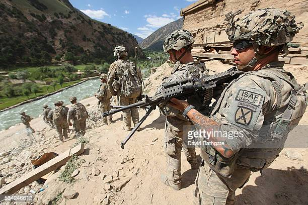 Soldiers from Charlie Company US Army 10th Mountain Division prepare to leave Firebase Lindstrom to patrol the town of Barge Matal Nuristan Province