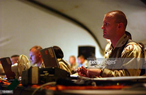 S soldiers from Coalition Joint Task Force 180 man laptop work stations inside the recently constructed CJTF180 Joint Operations Center May 29 2002...
