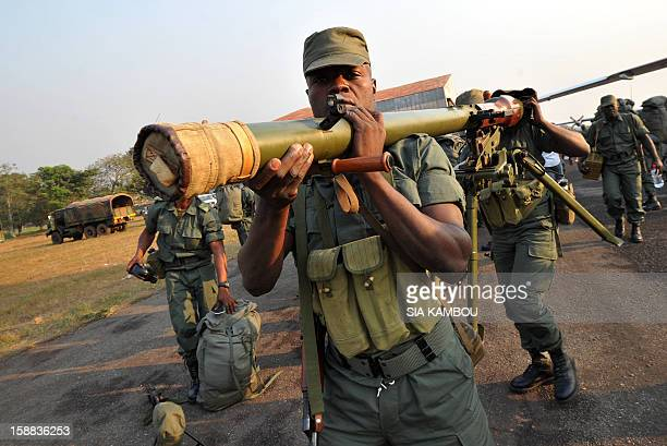 Soldiers from Congo Brazzaville part of the Multinaional Force of the Economic Community of Central African States unload military equipment as they...