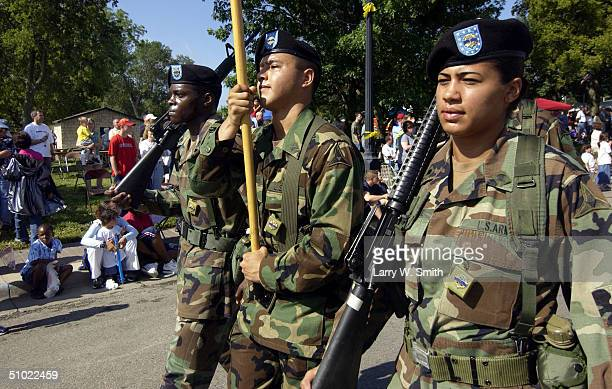Soldiers from Fort Riley Kansas march as part of the Sundown Salute parade and wreath laying ceremony on July 3 2004 in Junction City Kansas Members...