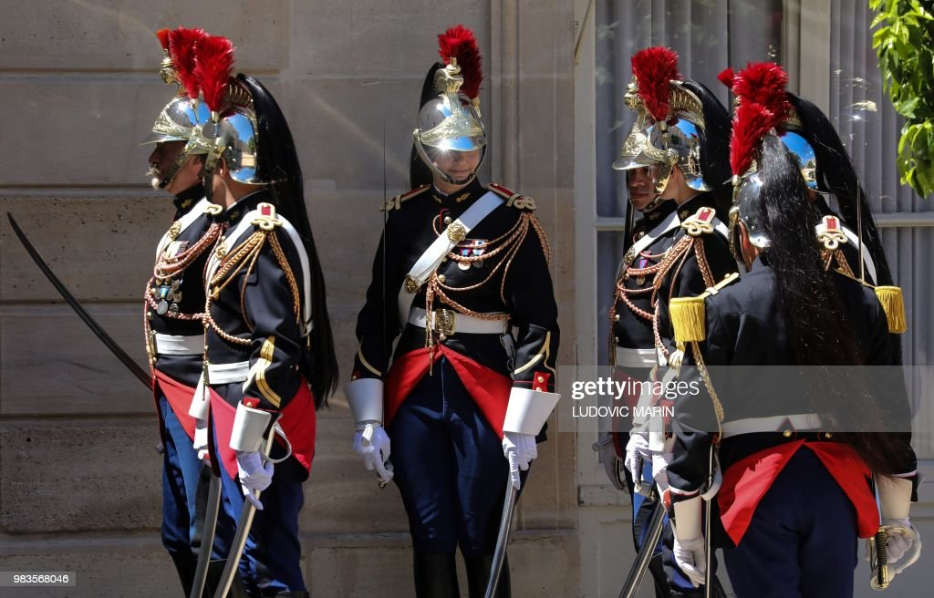 soldiers from france s republican guard gather as they prepare for a