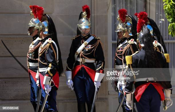 Soldiers from France's Republican Guard gather as they prepare for a welcome ceremony for Thailand's Prime Minister ahead of a meeting with the...