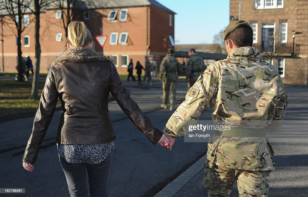 Soldiers from Headquarters Company 1st Battalion The Scots Guards return to their base at Bourlon Barracks and are reunited with their families following their recent deployment to Afghanistan on February 27, 2013 in Catterick, England. The soldiers are the first troops from 4 Mechanized Brigade to return to their base from their tour of duty in Afghanistan where they were responsible for the training and mentoring of the Afghan national security forces.