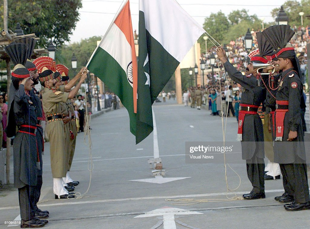 Soldiers From India (L) And Pakistan (R) Perform The Elaborate Daily Flag Lowering Ceremo : News Photo