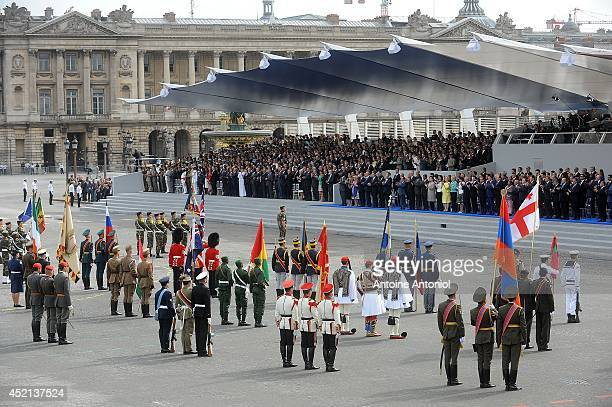 Soldiers from invited foreign delegations march down the ChampsElysees during the annual Bastille Day military parade on July 14 2014 in Paris France...