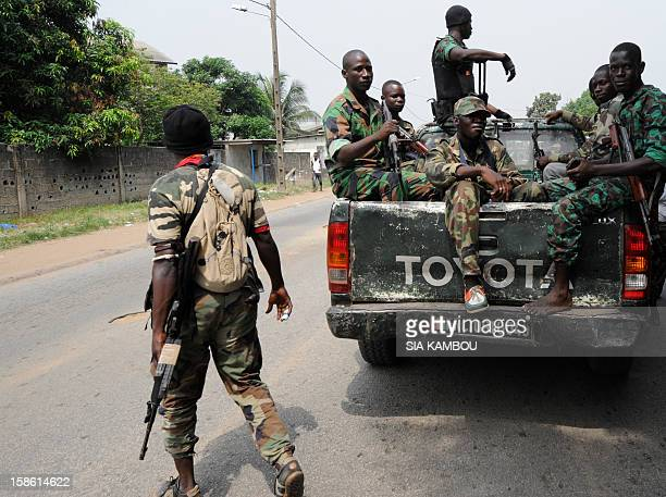 Soldiers from Ivory Coast's Republican Forces sit on a pickup truck near the paramilitary police barracks in the Yopougon district in the west of the...
