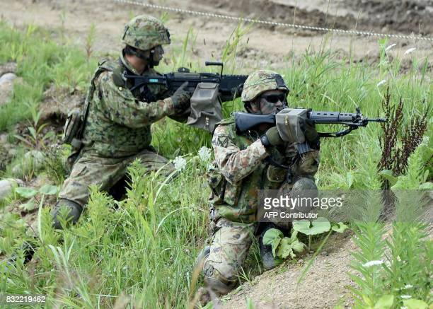 Soldiers from Japan's Ground SelfDefense Force take part in a field drill with US Marines during joint military exercises with in Eniwa Hokkaido...