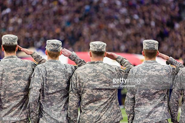 Soldiers from Joint Base LewisMcChord salute the American Flag at Husky Stadium on November 12 2016 in Seattle Washington prior to a game between USC...