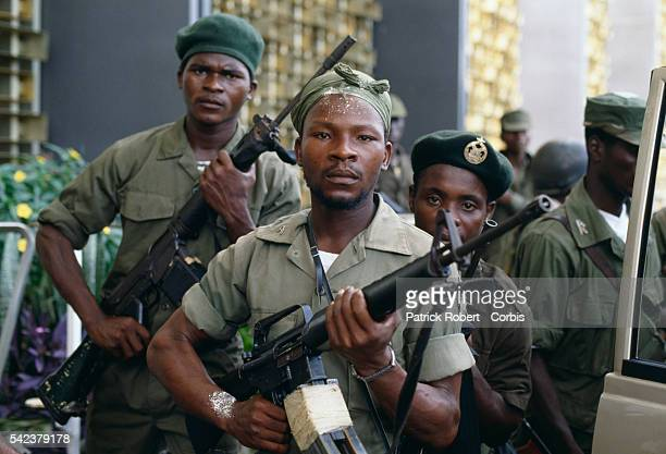 Soldiers from President Samuel Doe's Armed Forces of Liberia pose with their rifles Responding to years of government corruption and oppression in...
