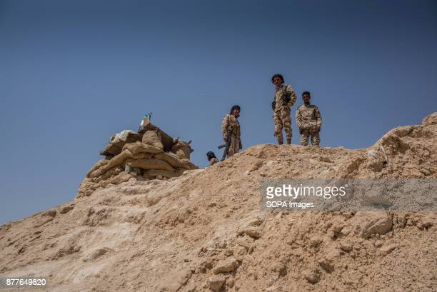 FSA soldiers from Quwat Al Nukhba Elite Brigades stand by their makeshift bunker on the frontlines of Deir Ez Zor in the Al Shaddadi desert It is...