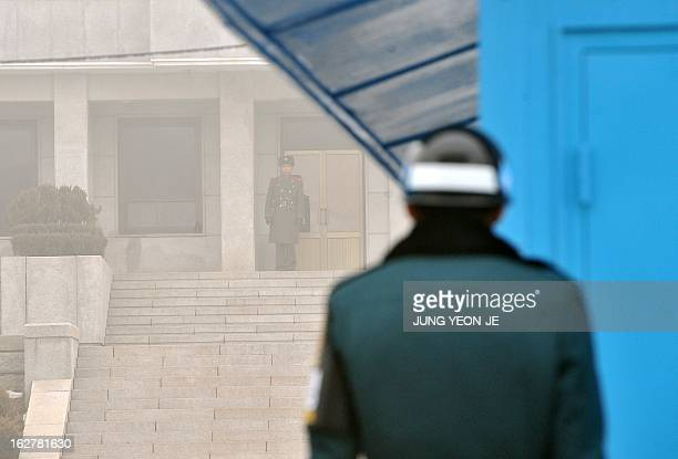 Soldiers from South Korea and North Korea stand guard on their respective sides at the truce village of Panmunjom in the demilitarized zone dividing...