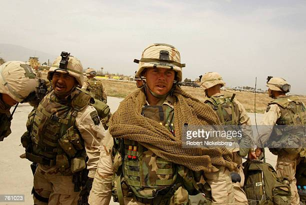 US soldiers from the 101st Airborne Battalion disembark from a Chinook helicopter at Bagram airbase April 6 2002 in Afghanistan The soldiers...