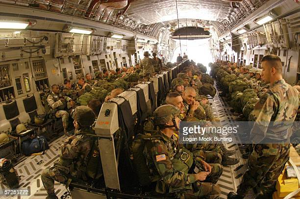 Soldiers from the 108th Military Police part of the XVIII Airborne Corps board the C17 Aircraft during their Proficency Jump on April 4 2006 The...