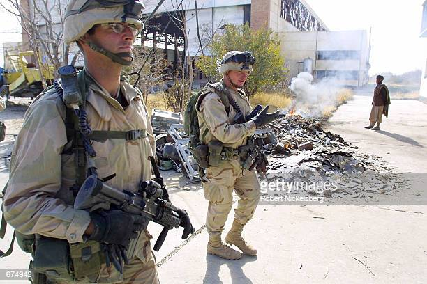 US soldiers from the 10th Mountain Division in Fort Drum NY supply security for US Special Forces December 2 2001 at the Bagram Airbase in...