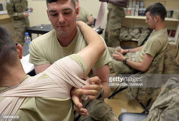 US soldiers from the 10th Mountain Division practice firstaid techniques at the forward operating base in Ghazni on May 23 2013 USled coalition...