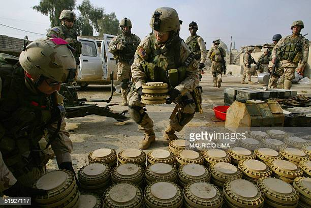 S soldiers from the 1st Battalion 24th Infantry Regiment collect land mines in the northern city of Mosul 370km from Baghdad 08 January 2005 US...