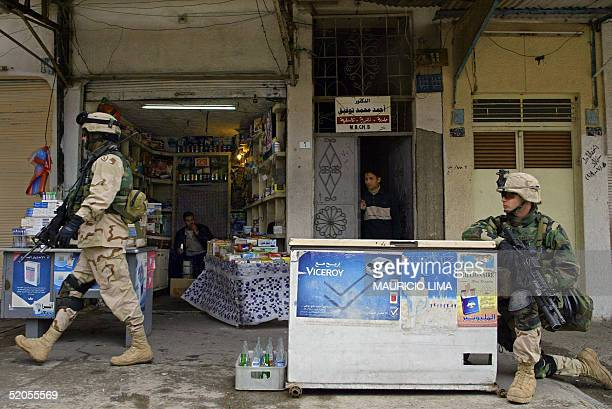 US soldiers from the 1st Battalion 24th Infantry Regiment patrol the commercial area in the northern Iraqi city of Mosul 370km of Baghdad 23 January...