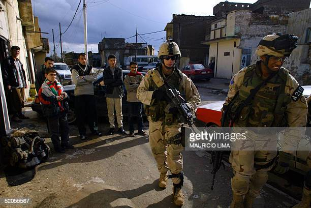 US soldiers from the 1st Battalion 24th Infantry Regiment walk in the street during a patrol at in an under privileged neighborhood in the northern...