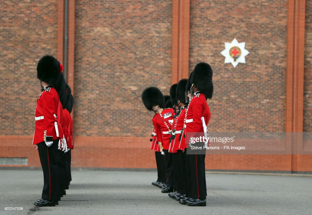 Soldiers from the 1st Battalion Coldstream Guards line up to be inspected by Major General Ben Bathurst at Victoria Barracks in Windsor, Berkshire, in preparation for Trooping the Colour.