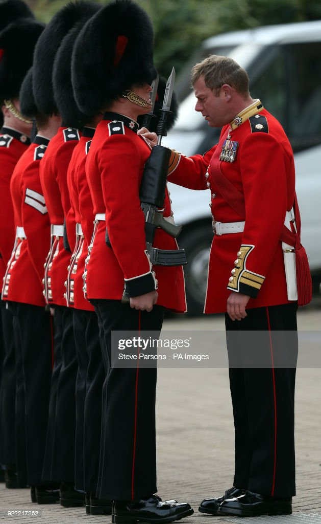 Soldiers from the 1st Battalion Coldstream Guards make last minute touches to their uniform before they are inspected by Major General Ben Bathurst at Victoria Barracks in Windsor, Berkshire, in preparation for Trooping the Colour.