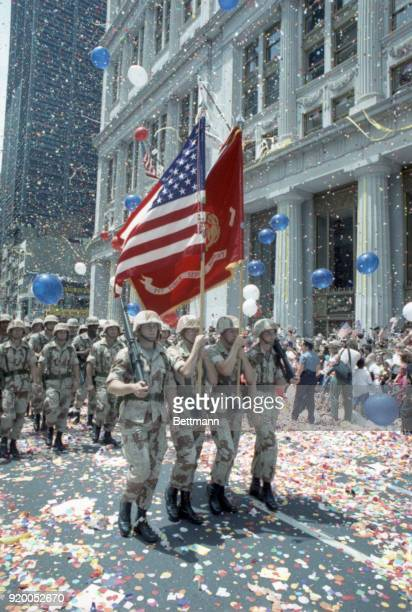 Soldiers from the 1st Service Support Group march through a blizzard of confetti up Broadway during the 'Operation Welcome Home' parade