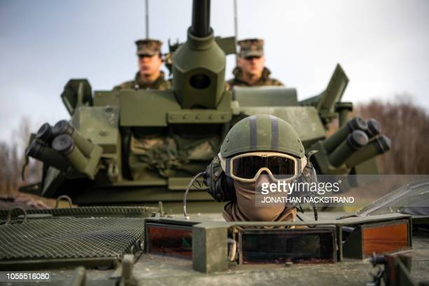US soldiers from the 2d Light Armored Reconnaissance Battalion are pictured in a LAV25 an eightwheeled amphibious armored reconnaissance...