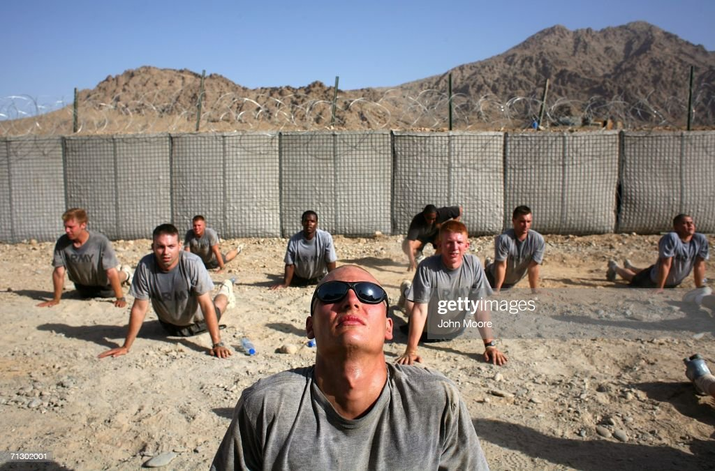 Soldiers from the 2nd Battalion 4th Infantry Regiment do morning exercises at a U.S. base at Deh Afghan June 27, 2006 in the Zabul province of southern Afghanistan. The troops are participating in Operation Mountain Thrust against Taliban fighters across southern Afghanistan.