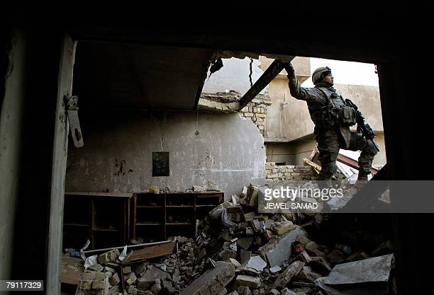 Soldiers from the 2nd Battalion, 4th Infantry Regiment, search a destoryed house in Baghdad 19 January 2008, as a curfew is slapped on the war-torn...