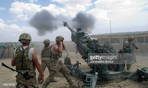 US soldiers from the 2nd Platoon of Alpha 177 Fa fire a 155mm artillery unit at Forward Operating Base Kuschamond on September 13 2011 The The...