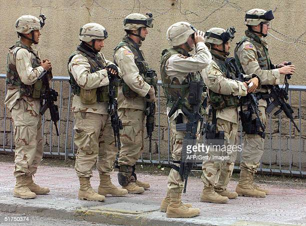 Soldiers from the 3rd Battalion 21st regiment of the Stryker Brigade secure the east side of one of the five bridges across the Tigris River in the...