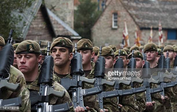 Soldiers from the 3rd Battalion the Yorkshire Regiment march along the High Street during a predeployment parade in Warminster in Wiltshire on March...