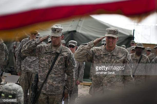 US soldiers from the 3rd Brigade 10th Mountain Division at a memorial service for SSG Essau Delapena and SGT Carlie Lee at Combat Outpost Carwile May...
