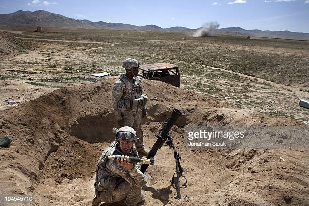 US soldiers from the 3rd Brigade 10th Mountain Division prepare to return mortar fire during an insurgent attack at the Jaghatu District Center May...