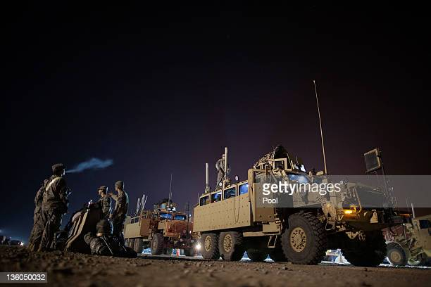 Soldiers from the 3rd Brigade Combat Team 1st Cavalry Division prepare their Mine Resistant Ambush Protected vehicles before departing Camp Adder to...