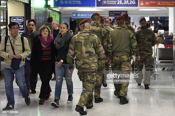 Soldiers from the 3rd Marine Infantry Parachute Regiment of Carcassonne leave Paris' Charles de Gaulle airport after arriving as part of a...