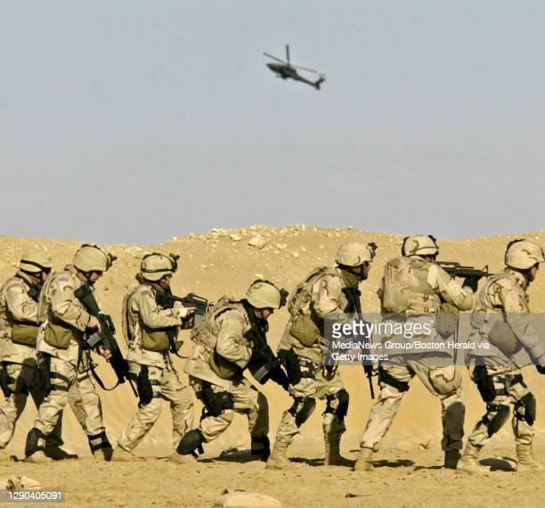 Soldiers from the 42nd MP Co. Participate in close quarter battle training as an Apache gunship swoops for a gun run. Later in the afternoon one of...
