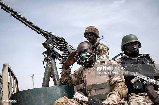 Soldiers from the 7th Division of the Nigerian Army on the back of a vehicle in Damboa Borno State northeast Nigeria on March 25 2016 On April 14...