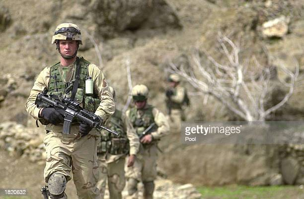 S soldiers from the 82nd airborne Bravo Company walk around the central part of the Baghran river valley as they search for remnants of Taliban and...